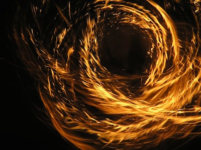 fire spun in a circle and looks like dancing flames