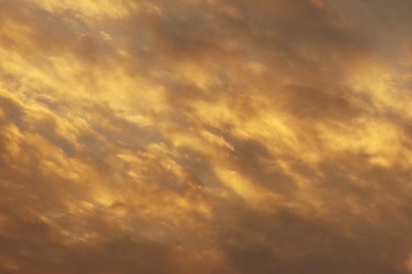 a cloudy sky with dappled sunlight
