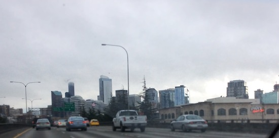 a picture of the Seattle skyline, heading southbound in Interstate-5