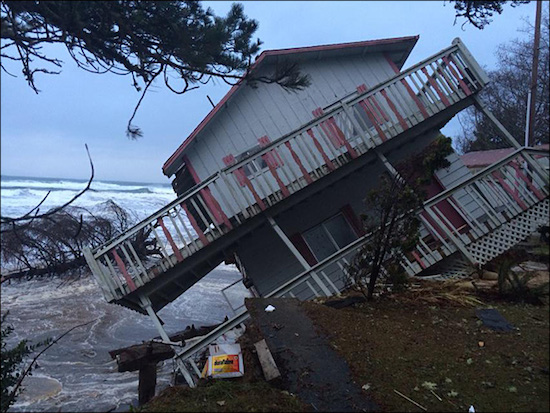 two story house partially falling off a cliff into the Pacific ocean at Washaway beach