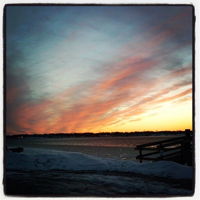 winter snowy beach with summer-like sunset by Kristin Statser Emmett