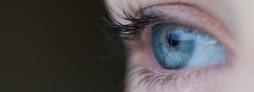 close up of a woman's blue eye, as symbol of being vulnerable