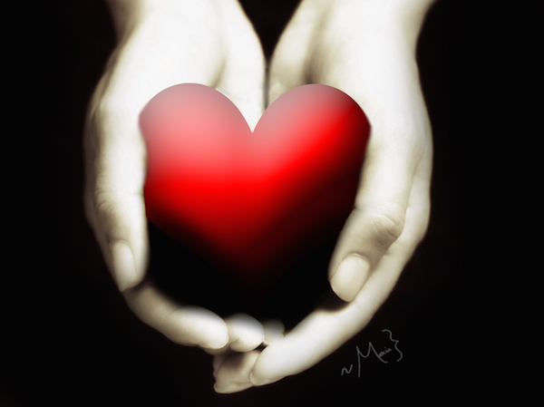 red heart cupped in human hands symbolizing sharing love with another