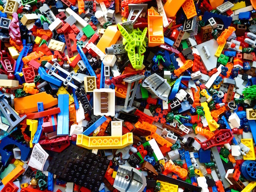 many sizes, colors, and shapes of Legos, waiting to build something